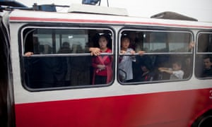 Passengers on a bus in Pyongyang shot during an organised media tour of the city.