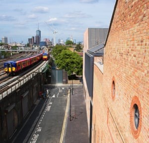 The gallery stands right next to the railway viaduct in Vauxhall, where a thicket of towers gathers on the horizon.