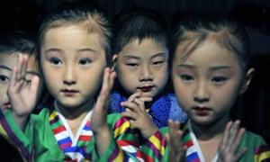 North Korean children finish a performance for foreign tourists to celebrate the 60th anniversary of Korean War.