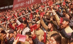 Soldiers and civilians brandish Mao's little red book at a rally in Beijing in April 1967.