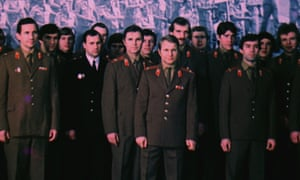RED ARMY film still showing the hockey team and various officials in uniform.