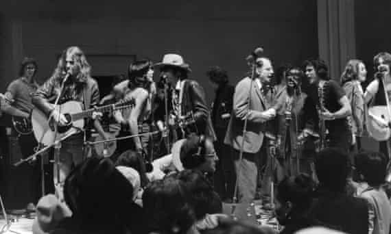 The Rolling Thunder Revue including Joan Baez, Bob Dylan, Allen Ginsberg and Roberta Flack perform a benefit concert in 1975.