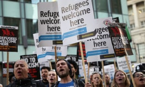 Refugees welcome – or keep out (illegal) 'migrants'? Protesters outside the Conservative party conference as the home secretary was speaking this week.
