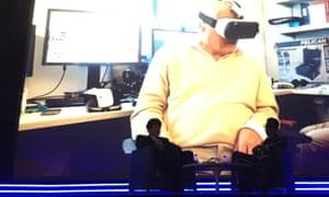 David Attenborough wearing a VR headset