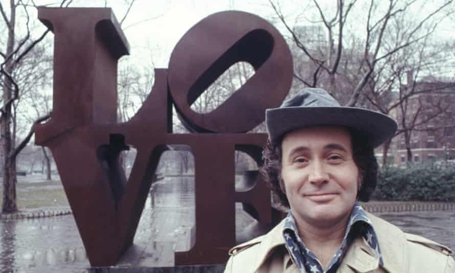 Robert Indiana with his 'LOVE' sculpture in Central Park, New York City in 1971.