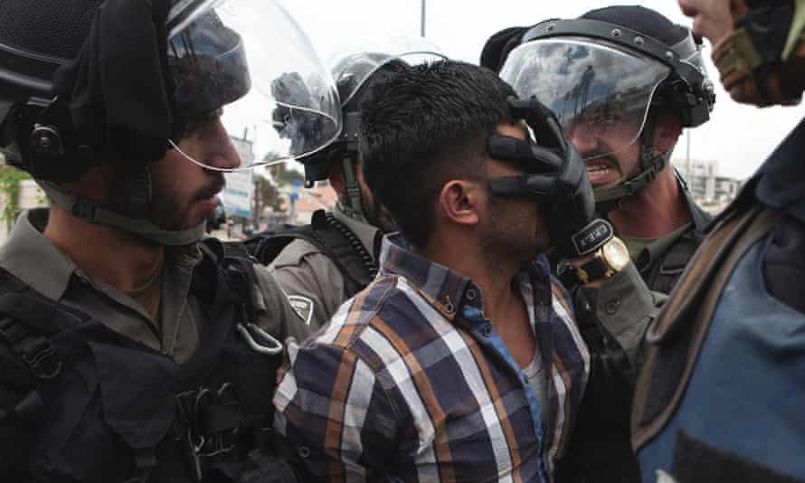 A Palestinian man is arrested by Israeli border police at Friday prayers in Jerusalem.