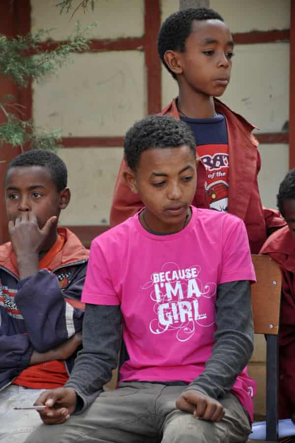 Boys discuss child marriage during children's parliament session at school