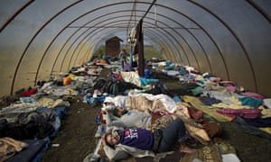 Syrian people sleep inside a greenhouse at a makeshift camp for asylum seeker, southern Hungary