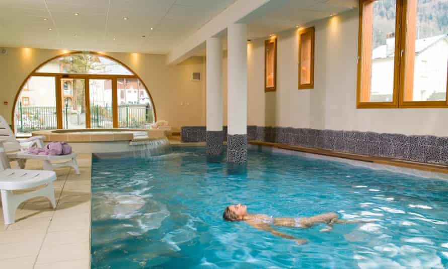 A woman in the pool relaxing at Thermes Sensoria spa, St Lary, France