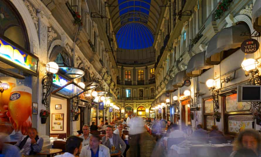 Diners at the restaurants in the Cicek Pasaji arcade, Istanbul, Turkey