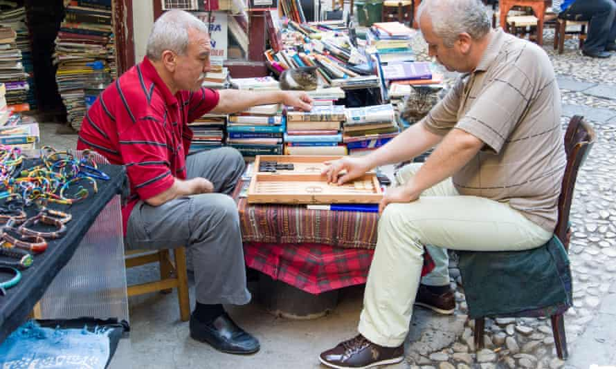 Men playing backgammon in Hazzopulo Passage off Istiklal Cadessi, Beyoglu, Istanbul, Turkey