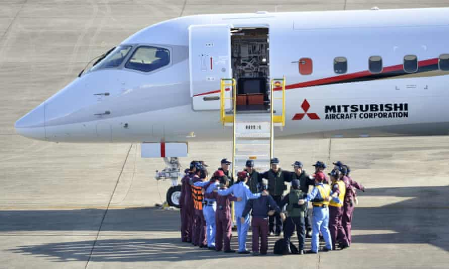 Flight crew members form a circle before the Mitsubishi Regional Jet's maiden test flight.