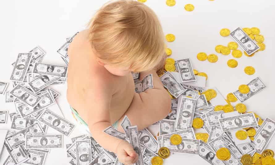 Photograph of baby surrounded by money