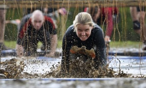 Racers go through the electric pool on their bellies to avoid being electrocuted by 80,000 volts in freezing water as  they take part in the Tough Mudder race in Oxfordshire,