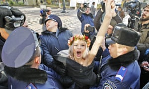 A Femen activist in front of the Ukrainian parliament before it approved a bill banning discrimination against gay people in the workplace.