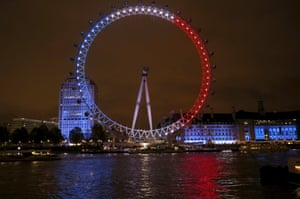 The blue, white and red colours of the French national flag light up the London Eye.