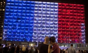 The Tel Aviv Municipality building is illuminated with the colours of the French national flag.