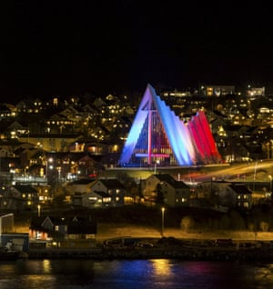 The Arctic Cathedral in Tromso, Norway displays the French national colours.
