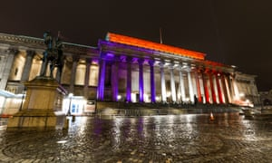 St George's Hall in Liverpool is illuminated in the French national colours.