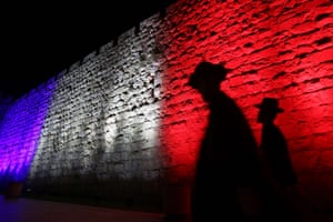 Jerusalem's Old City Ottoman Walls are illuminated in the red, white and blue of the French flag.
