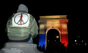 The Washington Square Park arch in New York is lit up with the French national colours in solidarity with the citizens of France.