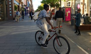 A cyclist on a shared pavement in Leicester.