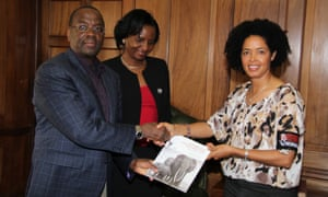 """Paula Kahumbu handing over the """"Scoping study on the prosecution of wildlife related crimes in Kenyan courts"""" on behalf of WildlifeDirect to the Chief Justice Willy Mutunga in January 2014."""