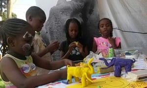"""Children making model elephants at an event organised by """"Hands Off Our Elephants"""". The campaign works to ensure that elephants will be part of these children's future, and their children's."""