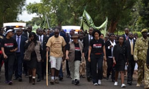 """The First Lady of Kenya, Her Excellency Margaret Kenyatta (centre with hat) in her role as Patron of the campaign """"Hands Off Our Elephants"""", launched in 2013. The marchers are accompanying Jim Nyamu (in the beige t-shirt) on part of his walk across Kenya t raise awareness about poaching."""
