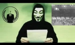 A man wearing a mask associated with Anonymous makes a statement in this still image from a video released on 16 November, 2015.