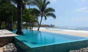 The outdoor swimming pool at Hacienda Eden, Playa Troncones, Guerrero, Mexico – and a view towards the beach and sea.