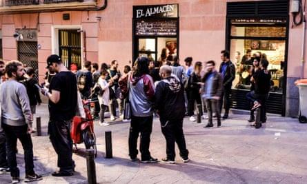 Pedestrians and visitors outside El Almacén de Discos, Madrid.