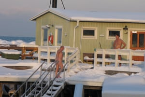 Bathers swim in the sea at Ribersborgs Kallbadhus through the winter.