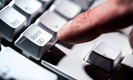 Finger pointing at a keyboard delete button