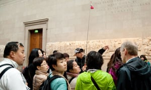 Tourists on a guided tour of the British Museum.