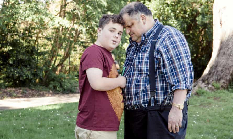 Steve Silberman and Leo Rosa, 14, who has autism and likes to calm himself with green straws from Starbucks.