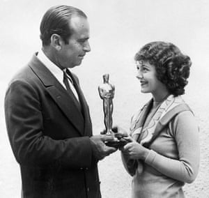 Douglas Fairbanks presents Janet Gaynor with an Oscar for best actress at the first Academy Awards in 1929.
