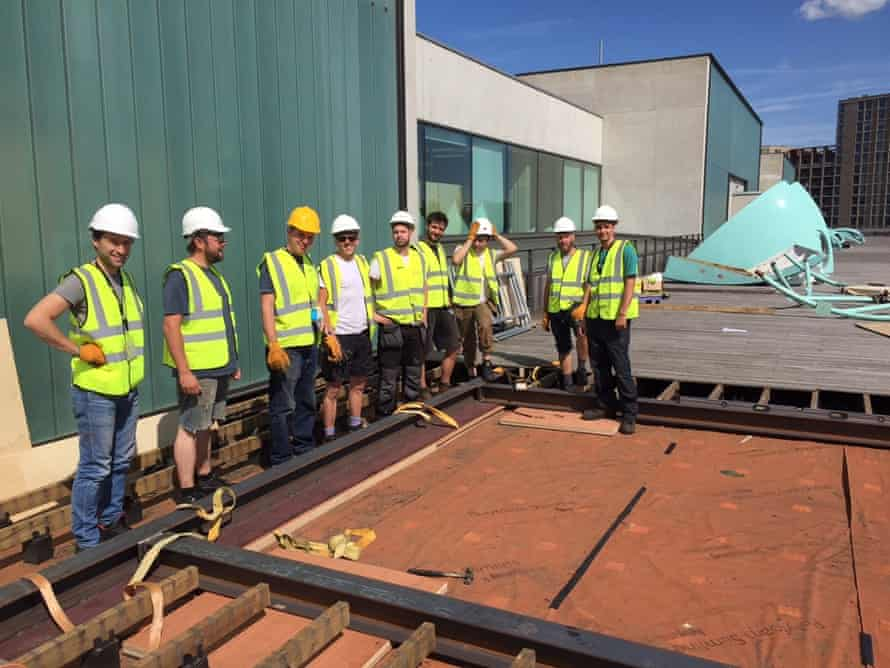 Helping to put his 'spaceship' back together on the CSM roof terrace: artist Craig Barnes, third from left.