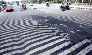 Road markings appear distorted during a heatwave, in New Delhi, India, 27 May 2015.