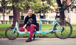 Daniel Kofler, chief executive, Bike Citizens sits on a bike