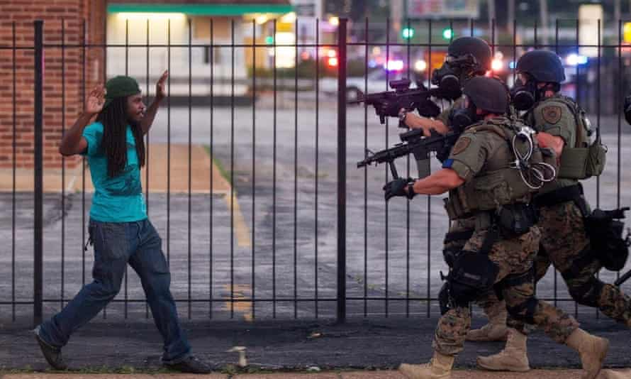 A man is arrested during protests against the death of Michael Brown, an unarmed black teenager killed by a police officer, in Ferguson, in August 2014.