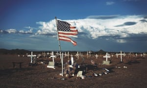 A shredded American flag at a grave site in Blackwater, Arizona.