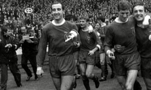 Gerry Byrne holding the lid of the FA Cup after Liverpool's win in 1965.