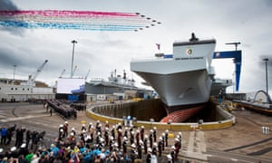 The Red Arrows fly past. The Queen names the largest warship built in the UK at a ceremony in Fife's Rosyth dockyard.