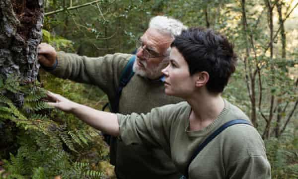 Lichen love ... botanist Ray Woods helps Rachel identify rare species. Photograph: Gareth Phillips.