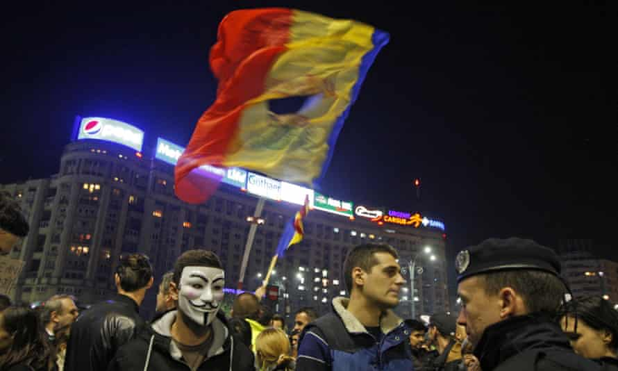 A politically symbolic torn flag flies at demonstrations against demonstrations triggered by the Bucharest nightclub fire.