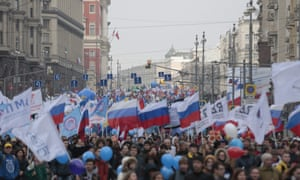 People take part in a demonstration marking the Day of Popular Unity on Tverskaya street in Moscow on Wednesday.