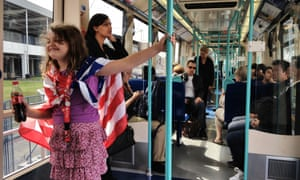 A young fan of Team USA travelling to the 2012 Olympics by DLR.