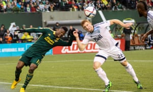 Tim Parker, right, heads the ball while under pressure during Vancouver Whitecaps' goalless draw with Portland Timbers in the MLS play-offs last week