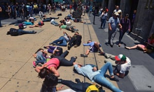 Activists lie on the street pretending to be dead during a flash mob to draw attention to the health risks caused by pollution in Mexico City.